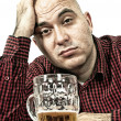 Sad beer drinker - Stock Photo