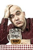 Sad beer drinker — Stock Photo