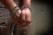 Mãos nas cadeias — Foto Stock