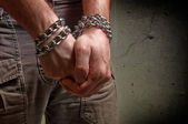 Hands in chains — Stock Photo