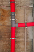 Red plastic water pipes — Stock Photo