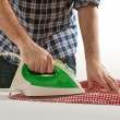 Man ironing — Stock Photo