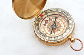 Compass in the snow — Stock Photo