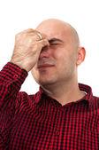 Worried man having headache — Stock Photo