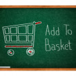Add to basket on Green chalkboard — Stock Photo