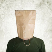 Hidden behind paper bag — Stock Photo