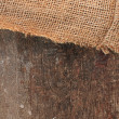Royalty-Free Stock Photo: Jute canvas over wood