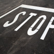 Stop sign on the road - Stock Photo
