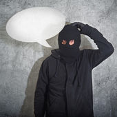 Confused burglar with speech balloon — Stock Photo
