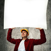 Construction worker with whiteboard — Stock Photo