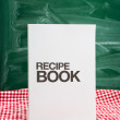 Recipe book on a kitchen table — Stock Photo #19780643