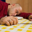 Man sleeping at the dinner table — Stock Photo #19780657