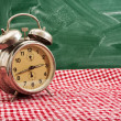 Stock Photo: Clock at table