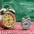 Clock at table — Stockfoto