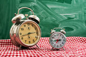 Clock at table — Stock Photo