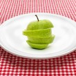Green apple on plate - Stock Photo