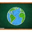 Earth on green school chalkboard - Stock Photo