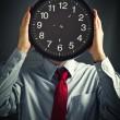 Businessman with black clock, deadline concept — Stock Photo