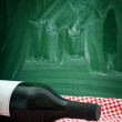 Wine bottle on a restaurant table - Stock Photo