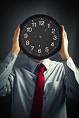 Businessman with black clock, deadline concept — Stock Photo