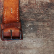 Leather belt on wooden background — Stock Photo