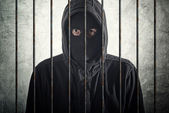 Arrested burglar behind bars — Stock Photo