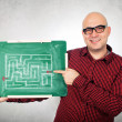 Man with labyrinth on chalkboard — Stock Photo