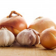 Onion and garlic clove - Stock Photo