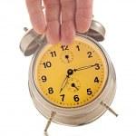 Hand knocking down vintage clock — Stock Photo