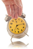Hand knocking down vintage clock — Stock Photo