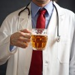 Royalty-Free Stock Photo: Doctor is drinking beer