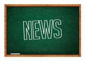 News on green chalkboard — Stock Photo