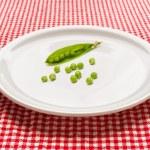 Постер, плакат: Raw peas on plate
