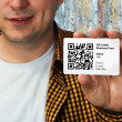 Construction worker with QR code business card - Stock Photo