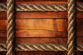 Wood texture and ropes — 图库照片