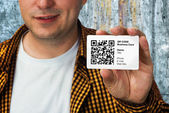 Construction worker with QR code business card — Stock Photo