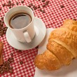 Coffee with croissant and cinnamon — Stock Photo