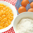 Flour, eggs and pasta — Stock Photo #23684445