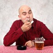 Beer drinker lighting up a cigarette — Stock Photo #23686343