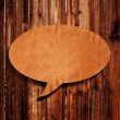 Stock Photo: Speech balloon on wood background