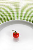 Cherry tomato on plate — Stock Photo