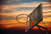 Old basketball hoop and a back board in sunset — Stock Photo