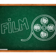 Film reel drawing on  a green chalkboard - Stock Photo