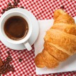 Coffee with croissant and cinnamon - Stock Photo