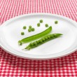 Raw peas on plate - Stock Photo
