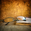 Rading glasses and newspaper — Stock Photo