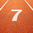 Number seven on running track - Stock Photo