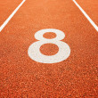 Number eight on running track - Stock Photo