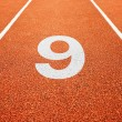 Number nine on running track - Stock Photo