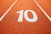 Number ten on running track — Stock Photo